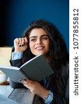woman sitting in coffee shop... | Shutterstock . vector #1077855812
