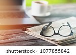 newspaper with computer on table | Shutterstock . vector #1077855842