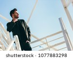 handsome confident man with... | Shutterstock . vector #1077883298