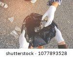 young volunteers with garbage... | Shutterstock . vector #1077893528