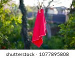 a red rag is dried on a rope... | Shutterstock . vector #1077895808