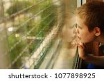 cute 10 year old autistic boy... | Shutterstock . vector #1077898925