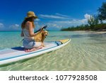 girl in sun hat paddles with... | Shutterstock . vector #1077928508