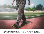 adult man jog for his health on ... | Shutterstock . vector #1077941288