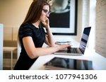 woman in glasses successful...   Shutterstock . vector #1077941306