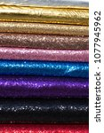 Small photo of colorful scaly fabric in the shop. day fashion textile from Turkey.