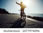 silhouette cyclist riding bike... | Shutterstock . vector #1077974096