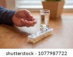 closeup of man's hand taking...   Shutterstock . vector #1077987722