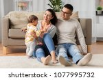 family  parenthood and people... | Shutterstock . vector #1077995732