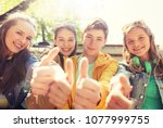 friendship  gesture and people... | Shutterstock . vector #1077999755