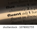 Small photo of fluent word in a dictionary. fluent concept