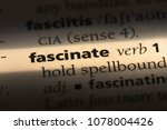 Small photo of fascinate word in a dictionary. fascinate concept