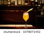 tequila sunrise cocktail on bar | Shutterstock . vector #1078071452
