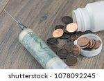 Cash Infusion  A Syringe With A ...