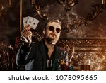 a wealthy mature man smoking... | Shutterstock . vector #1078095665