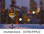 a glass of white wine on table... | Shutterstock . vector #1078159922