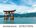 Stock photo view of the torii gate of itsukushima shrine at high tide floating in the water of the island of 1078173596
