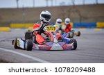 young go cart racer on circuit   Shutterstock . vector #1078209488