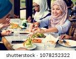 islamic women friends dining... | Shutterstock . vector #1078252322
