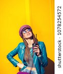 young cool woman in jacket on... | Shutterstock . vector #1078254572