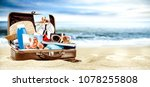 brown retro suitcase on beach... | Shutterstock . vector #1078255808