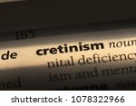 Small photo of cretinism word in a dictionary. cretinism concept