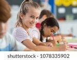 happy beautiful schoolgirl... | Shutterstock . vector #1078335902