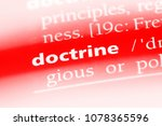 Small photo of doctrine word in a dictionary. doctrine concept