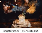 barman prepares cocktail with...   Shutterstock . vector #1078383155
