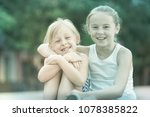 portrait of two girls playmates ...   Shutterstock . vector #1078385822