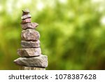 Stacked Stone Pyramid In Front...