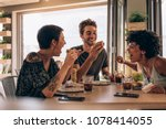 group of friends having burger... | Shutterstock . vector #1078414055