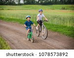 two kids riding on bikes... | Shutterstock . vector #1078573892