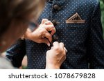 woman buttoning groom's suit | Shutterstock . vector #1078679828