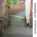 Small photo of Twisting alleyway steps scene