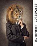 lion in a suit. man with a head ... | Shutterstock . vector #1078692698