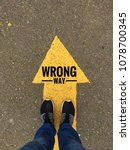 wrong way text on yellow arrow... | Shutterstock . vector #1078700345