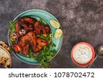 spicy tandoori chicken wings... | Shutterstock . vector #1078702472