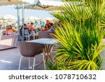 palm leaves in italian cafe... | Shutterstock . vector #1078710632