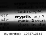 Small photo of cryptic word in a dictionary. cryptic concept