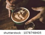 barista use tiny metal pin draw ...   Shutterstock . vector #1078748405