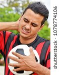 Small photo of Adult Male Soccer Player And Soreness
