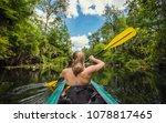 adventuresome woman kayaking...   Shutterstock . vector #1078817465