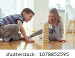 two happy siblings playing a... | Shutterstock . vector #1078852595