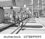 heat exchangers in a refinery.... | Shutterstock . vector #1078899095