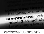 Small photo of comprehend word in a dictionary. comprehend concept