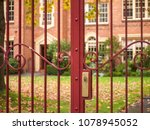 Red Wrought Iron Gate With...