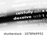 Small photo of deceive word in a dictionary. deceive concept