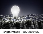 illuminated light bulb standing ... | Shutterstock . vector #1079001932
