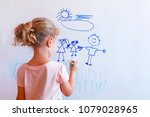 little girl draws  family with... | Shutterstock . vector #1079028965